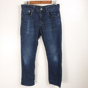 Chip and Pepper men's dark blue distressed jeans.